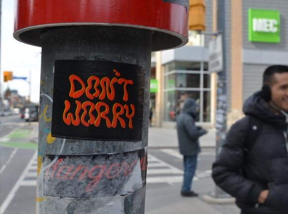 don't worry sticker on a pole