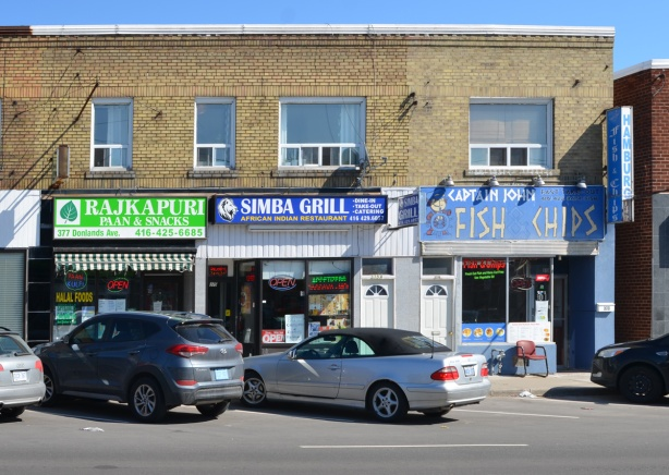 3 restaurants on a street, an Indian Paan and snack plce, an Africa Indian restaurant called Simba, and a fish and chip restaurant