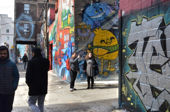people in graffiti alley