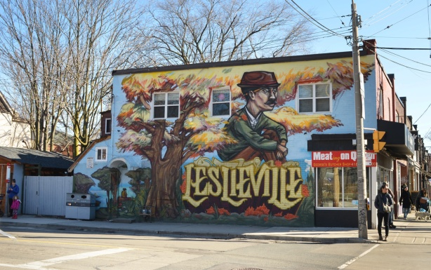 Leslieville mural by elicser of a man sitting under o tree in autumn