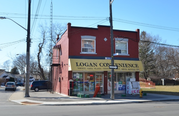 Logan convenience store, 2 storey red brick building, on a corner, with no other building next to it