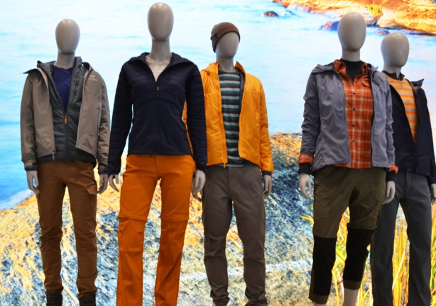 mannequins dressed in outside clothing, long pants, hats, jackets, in orange and blue tones,