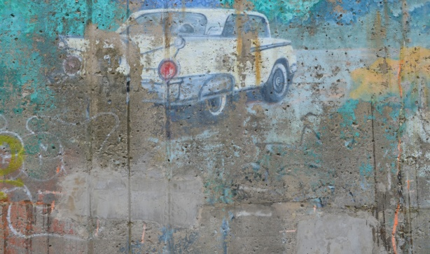 old faded mural of a small white car