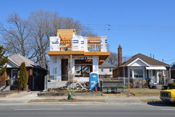 construction of a new 2 storey house in between two square bungalows