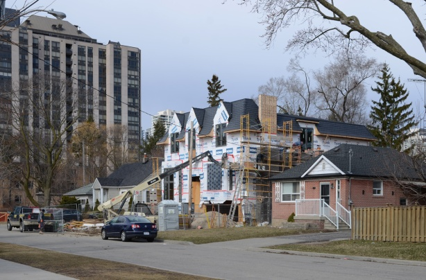 large new house being built in Willowdale, on Maplehurst Ave., in place of a small bungalow like the house beside it