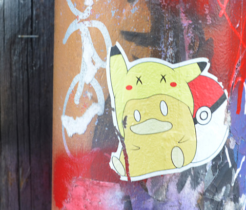 pokemon and poke ball sticker on a painted pole