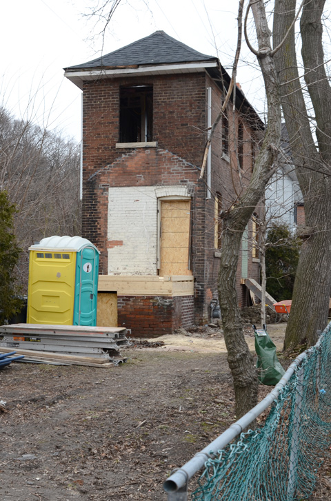 very narrow brick house has been gutted and has no windows