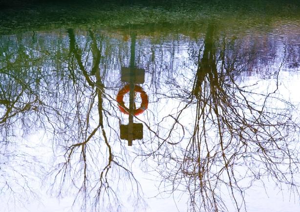 reflections of lifesaving equipment beside the Wilket Creek