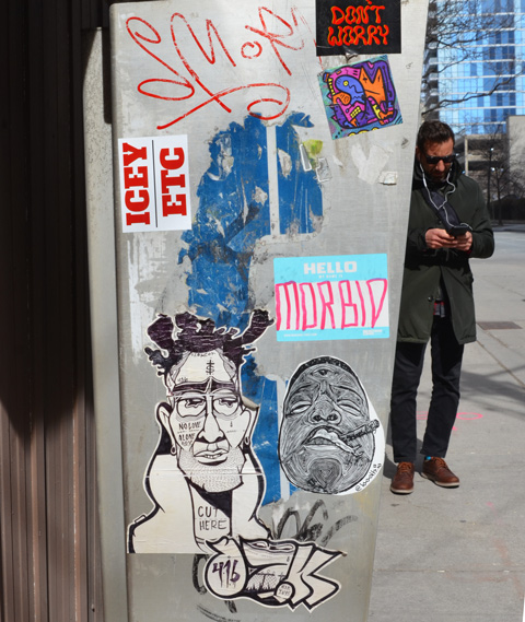 stickers on the side of a phone booth