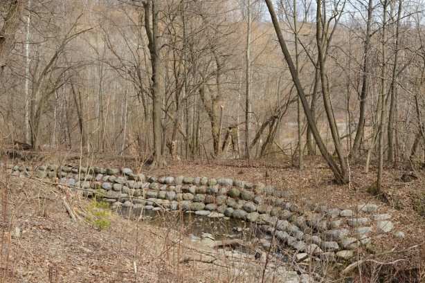 old rock wall along the banks of Mud Creek, trees, path,