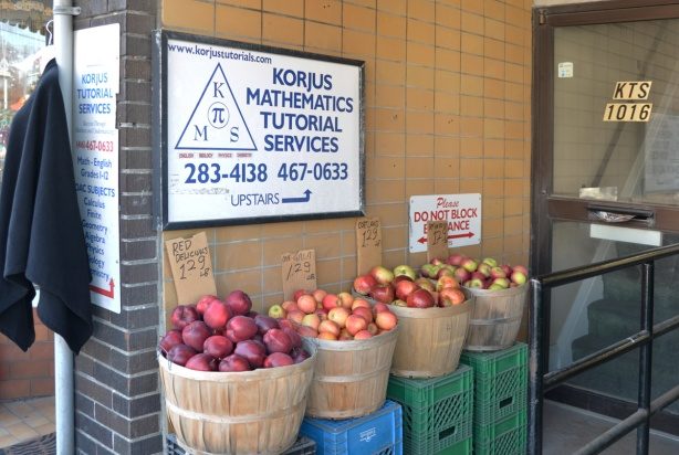 4 bushel baskets of apples in a doorway of the Korjus Mathematics Tutorial Services