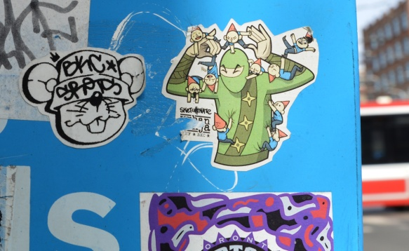 urban ninja squadron sticker, in colour, on a blue background - side of a Bell phone booth