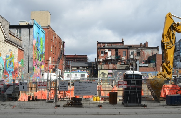 construction site on Richmond street backing onto Graffiti Alley with lots of walls covered with street art and murals