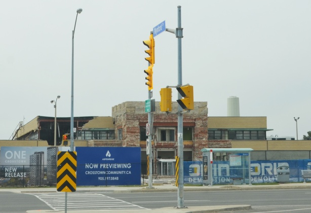 corner of Don Mills and Eglinton during Crosstown construction, IBM building in the background