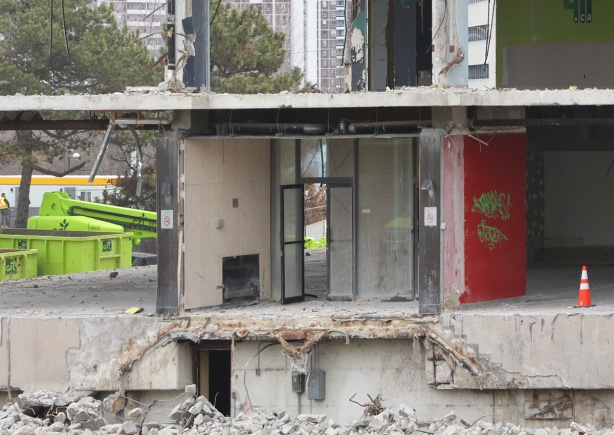 lower levels of a building that has been partially demolished, all the exterior walls have been removed, leaving just the interior walls