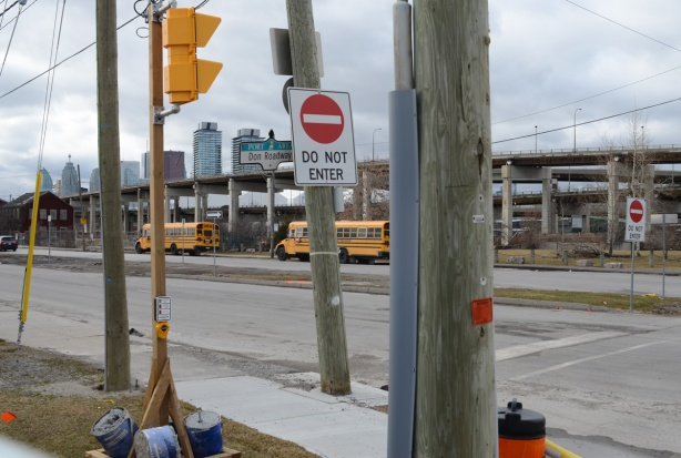 Villiers street at Don Roadway, two school buses parked here, Gardiner Expressway in the background