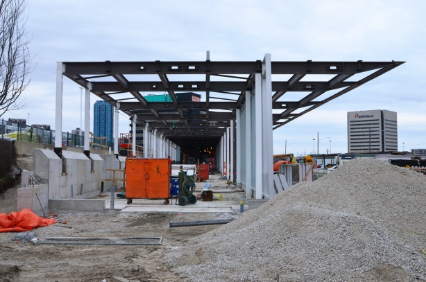 west end of the new bus bays at Eglinton and Don Mills, under construction, glass walls and roof
