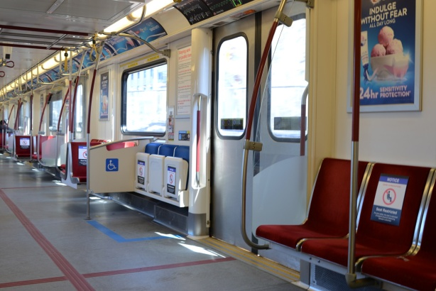 empty seats on TTC subway car, signs on seats saying do not sit here, social distancing measure re covid-19