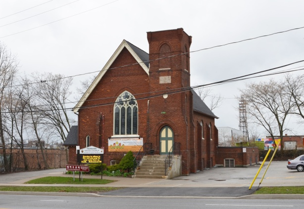 exterior of Fairbank United Church, red stone church, on Dufferin Ave