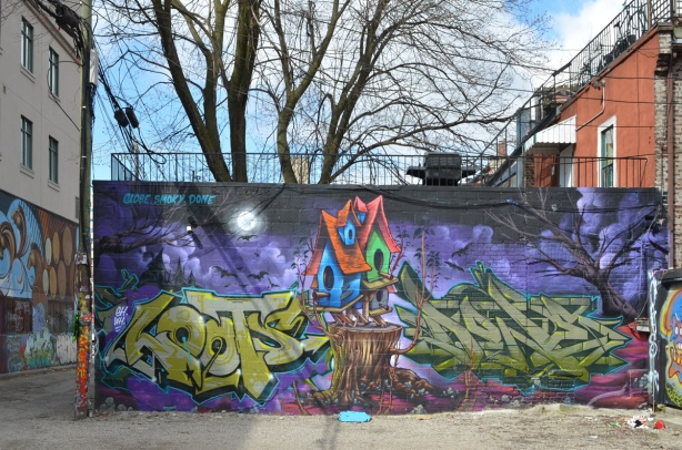 large mural by globe, smoky, and done of a bird house on purple background with green tag text