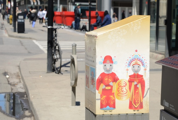 Canada Post mailbox decorated with a picture of a mouse couple dressed in Chinese traditional outfits, cartoon-like, to celebrate lunar new year and year of the rat