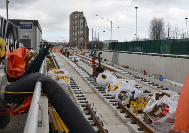 construction of the Crosstown l r t, tracks being laid on the above ground portion of the line, near Eglinton.