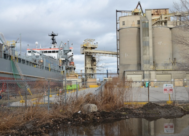 large laker ship docked beside Lafarge cement