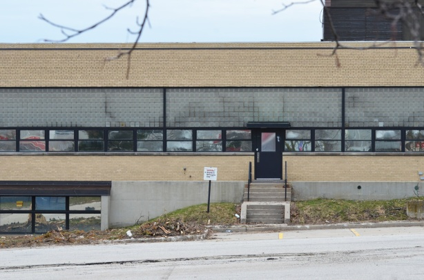 east side of old IBM building at Don Mills and Eglinton, low rise yellow brick, horizontal windows, empty and ready for demolition