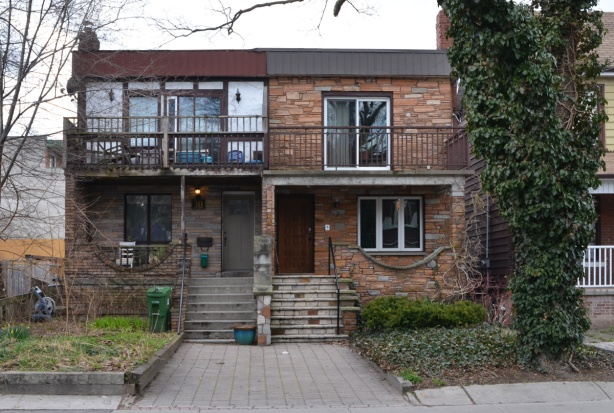 a house, semi-divided, two storey, porch, rounded lines on the porch railing,