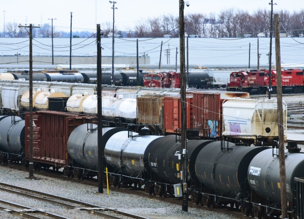 boxcars and tankers waiting on tracks at the CPR yard