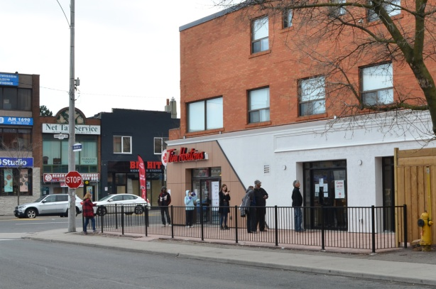 line up outside Tim Hortons, social distancing for Covid