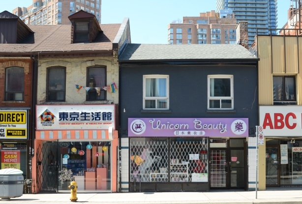 two store fronts on Yonge Street, Unicorn Beauty and a Japanese restaurant