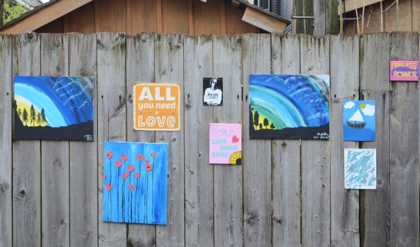 paintings on a fence