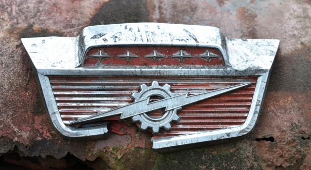 junked, old cars, McLeans Auto Wreckers, broken chrome badge of a car