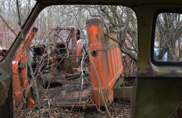 junked, old cars, McLeans Auto Wreckers, orange cab of a truck