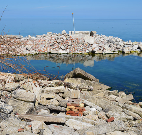 piles of rock, concrete bits, rebar, construction waste, forming parts of Tommy Thompson park