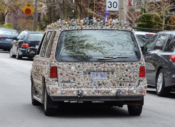 back of van covered with shells and small toys