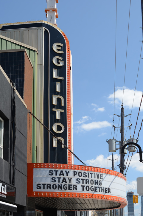 marquee on Eglinton Theatre that says stay positive stay strong stronger together