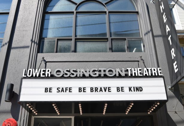 front of Lower Ossington Theatre with marquee that says Be safe Be brave Be kind
