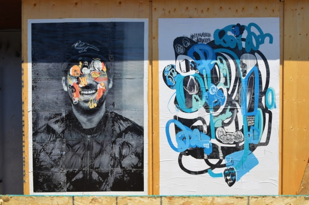 2 large street art posters on wood construction hoardings