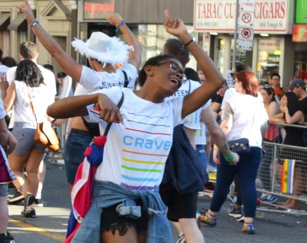 women dancing in the street, pride parade