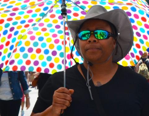 carrying a big polka dot umbrella