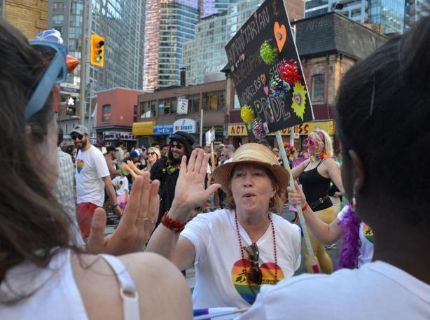 high fives, pride parade