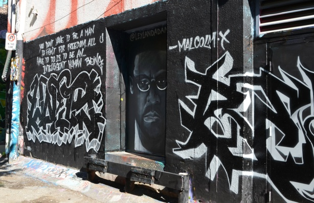 mural dedicated to Malcom X with his portrait and one of his quotes