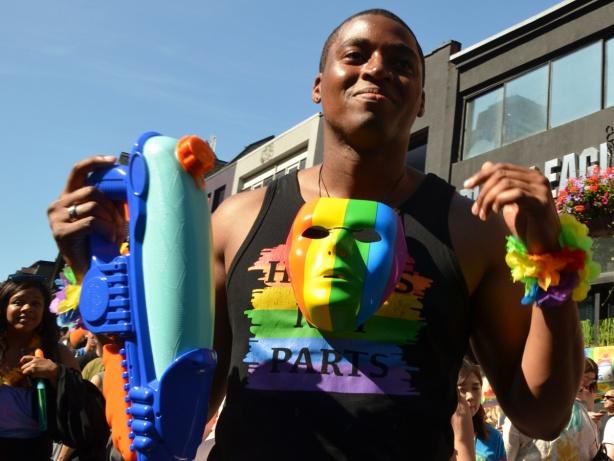 man with rainbow mask