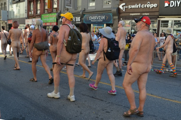 naked people in pride parade, backside view, bums,