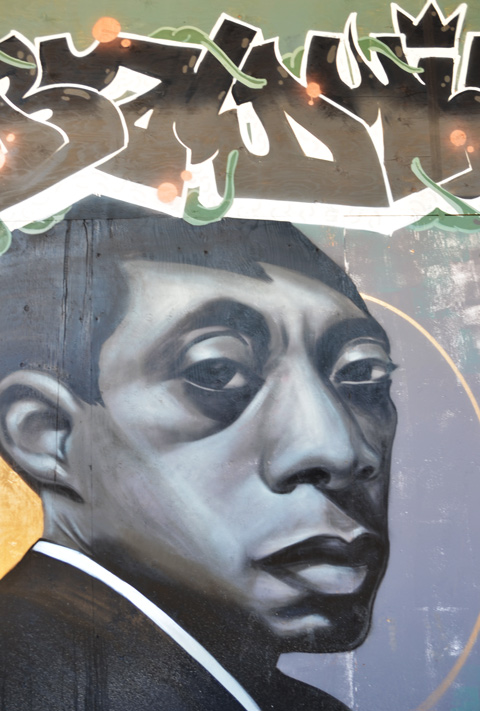 portrait of James Baldwin, mural in Graffiti Alley, by Phillip Saunders