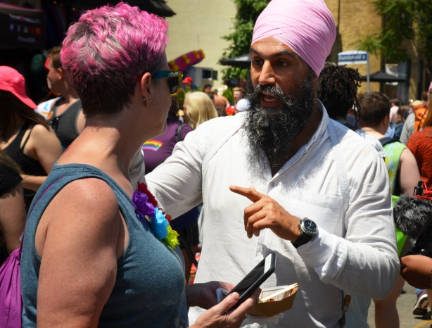 Singh, leader of federal NDP at pride parade, in pink turban