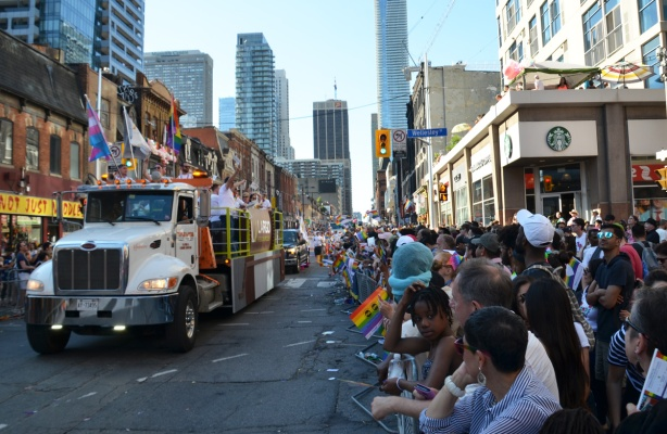 truck pulling float down Yonge Street for Pride parade