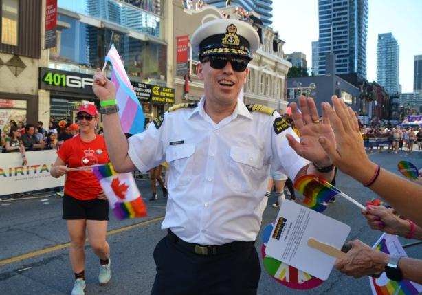 man in uniform in pride parade